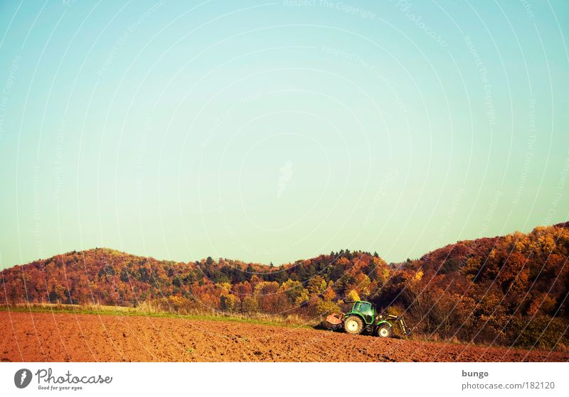 rusticus studiosior Colour photo Exterior shot Day Sunlight Wide angle Farmer Machinery Agricultural machine Agriculture Tractor Environment Nature Landscape