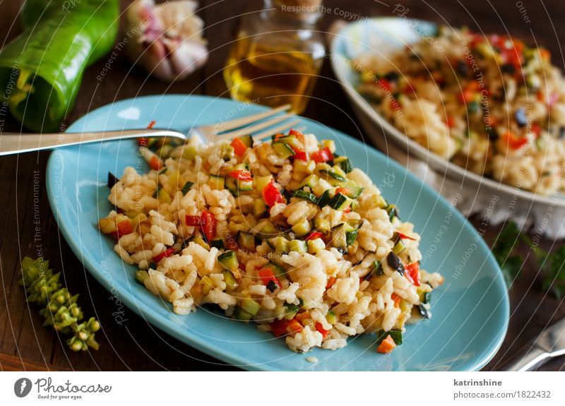 Risotto with vegetables Vegetable Grain Herbs and spices Cooking oil Nutrition Lunch Dinner Vegetarian diet Diet Italian Food Plate Bottle Fork Wood Delicious