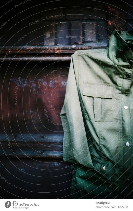 Old Green Clothing Jacket Hip & trendy Rain wear Partially visible Section of image Dull Vignetting Rain jacket Olive Invalided out Parka Old clothes