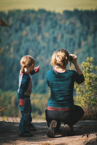 farsightedness Joy Happy Leisure and hobbies Children's game Human being Feminine Parents Hiking Vantage point Infancy Childhood memory Study Life Binoculars