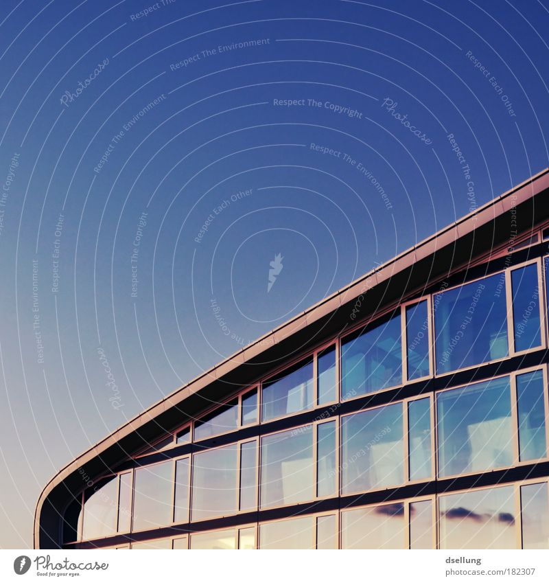 Part of a glazed building with a bright blue sky Colour photo Exterior shot Deserted Copy Space left Copy Space top Evening Twilight Contrast Reflection Sunrise