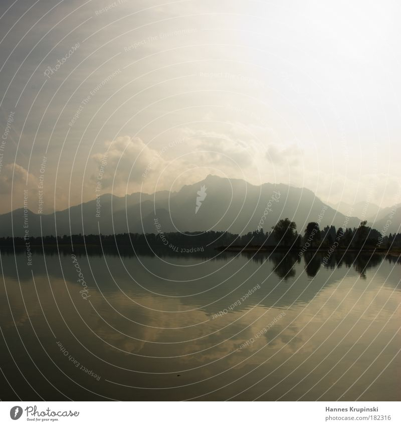 Mirror, mirror on the lake Colour photo Exterior shot Deserted Day Reflection Tourism Trip Landscape Water Sky Clouds Summer Beautiful weather Alps Mountain
