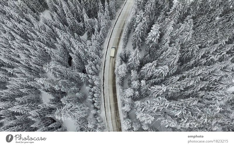 Snowy Winter Road with a Car Mountain Nature Landscape Tree Forest Street View from the airplane Freeze White over pines coniferous Curve country Rural scenery