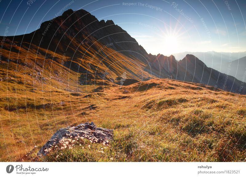 autumn sunrise in rocky Alps, Austria Sky Nature Vacation & Travel Sun Landscape Mountain Meadow Autumn Rock Gold Vantage point Serene Cliff Alpine
