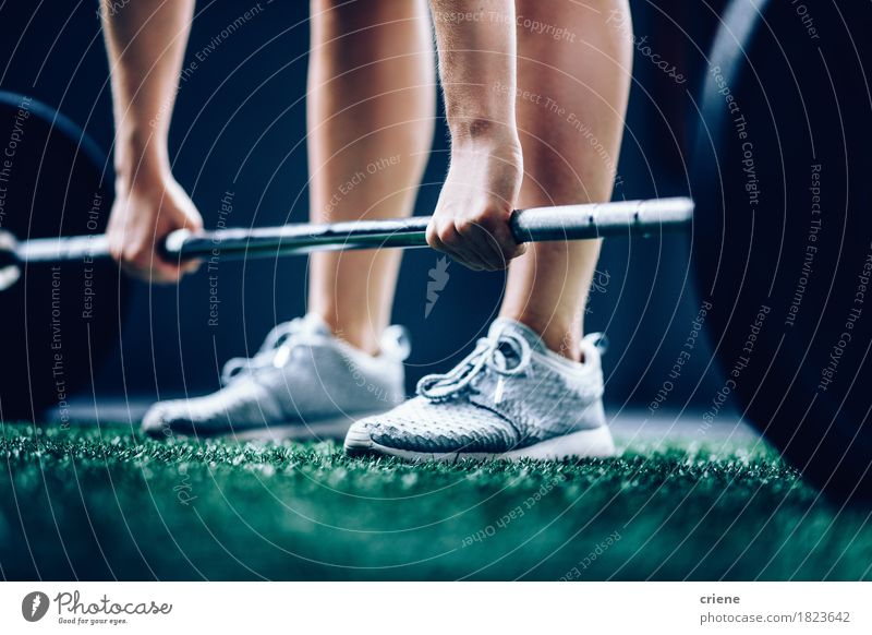 Close-Up of fit girl picking up barbell for workout in gym Lifestyle Body Leisure and hobbies Sports Fitness Sports Training Hand Legs Feet Strong Power