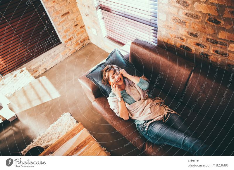 Mature Woman laying on phone call at home Lifestyle Joy Happy Relaxation Leisure and hobbies House (Residential Structure) Sofa Living room To talk Cellphone