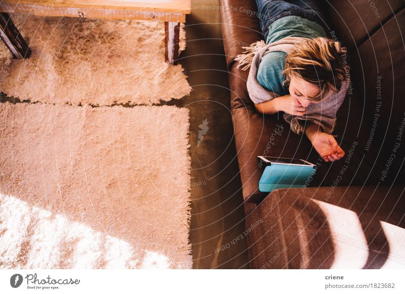 Mature Adult Woman on Sofa reading E-Book on digital Tablet Human being Woman Old Adults Senior citizen Lifestyle Copy Space Modern Technology Telecommunications To enjoy Reading Female senior Internet Information Technology Sofa