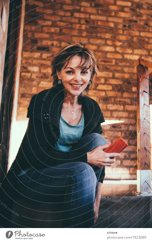 Mature Happy Woman smiling in Camera holding smartphone in hands Human being Joy Adults Senior citizen Lifestyle Business Room Office Modern Communicate