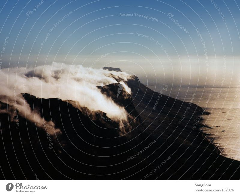tablecloth Vacation & Travel Landscape Sky Clouds Fog Mountain Coast Ocean Gigantic Tall Loneliness Change Table mountain Cloud cover Fog bank Day Colour photo
