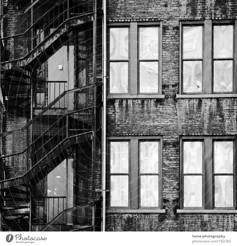 fire escape Black & white photo Detail Structures and shapes Deserted Contrast Reflection Central perspective Long shot New York City Americas USA Town
