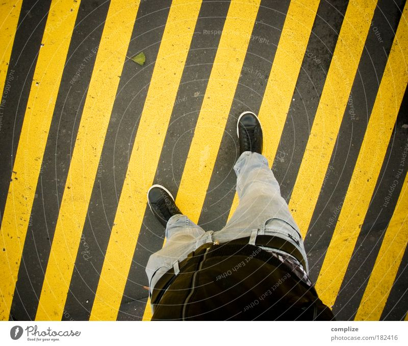 Human being Man Adults Yellow Street Legs Feet Art Going Concrete Masculine Jeans Media Diagonal Traffic infrastructure Footwear