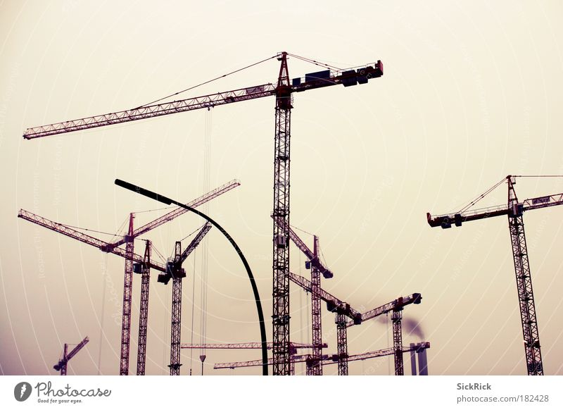 globalization Subdued colour Exterior shot Copy Space top Crane Dirty Dark Yellow Construction site Many Industry