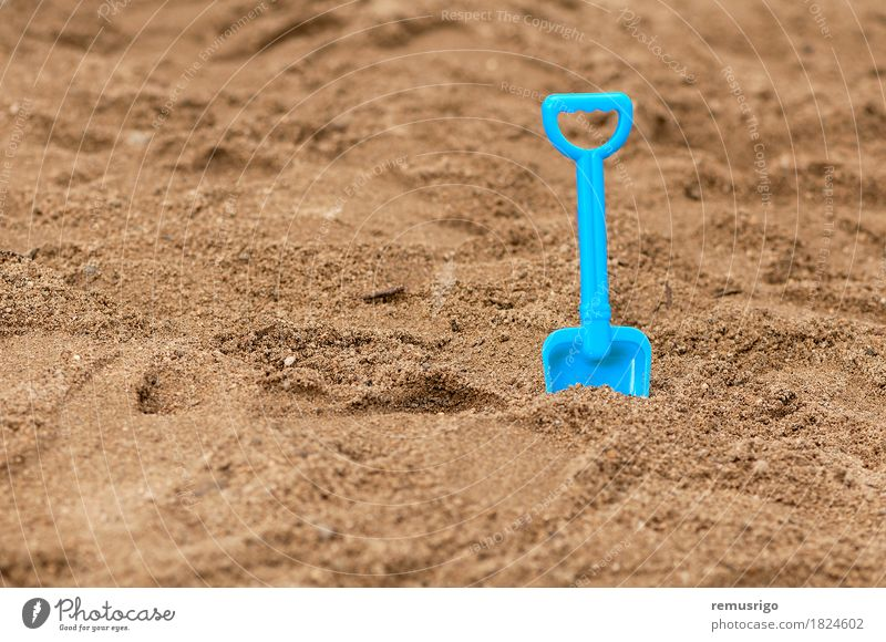 Sandpit shovel in the sand Joy Playing Vacation & Travel Summer Beach Ocean Kindergarten Child Toys Plastic Dirty Blue holiday kid sandbox Colour photo