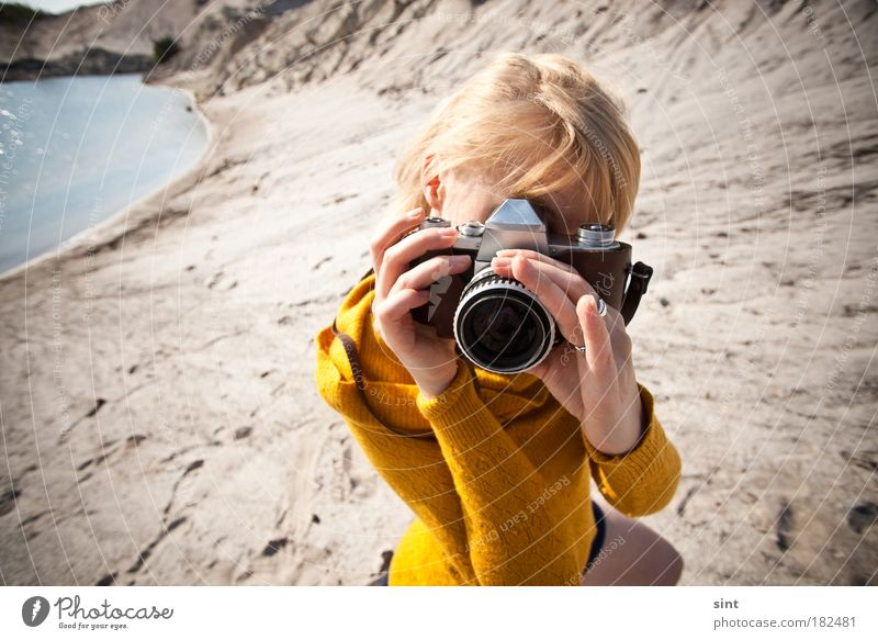 Human being Youth (Young adults) Feminine Sand Landscape Photography Blonde Adults Retro Camera Observe To hold on Discover Passion Beautiful weather