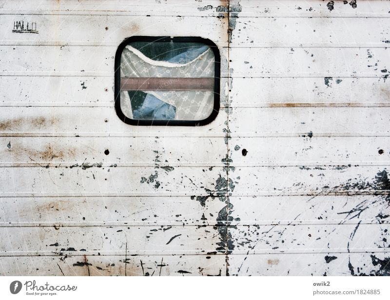 loft Mobile home Wall (barrier) Wall (building) Facade Window Curtain Container Tin Metal Characters Old Trashy Gloomy Decline Transience Destruction