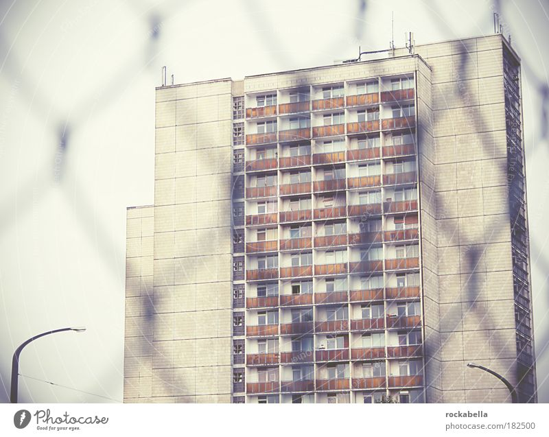 High-rise view through wire mesh fence Subdued colour Exterior shot Day Town House (Residential Structure) Building Architecture Wall (barrier) Wall (building)