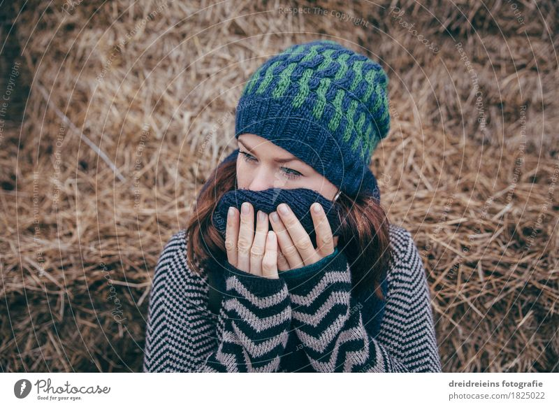 Melancholy. Feminine Young woman Youth (Young adults) Woman Adults 1 Human being Jacket Scarf Cap Think Sadness Cry Soft Emotions Hope Humble Concern Grief