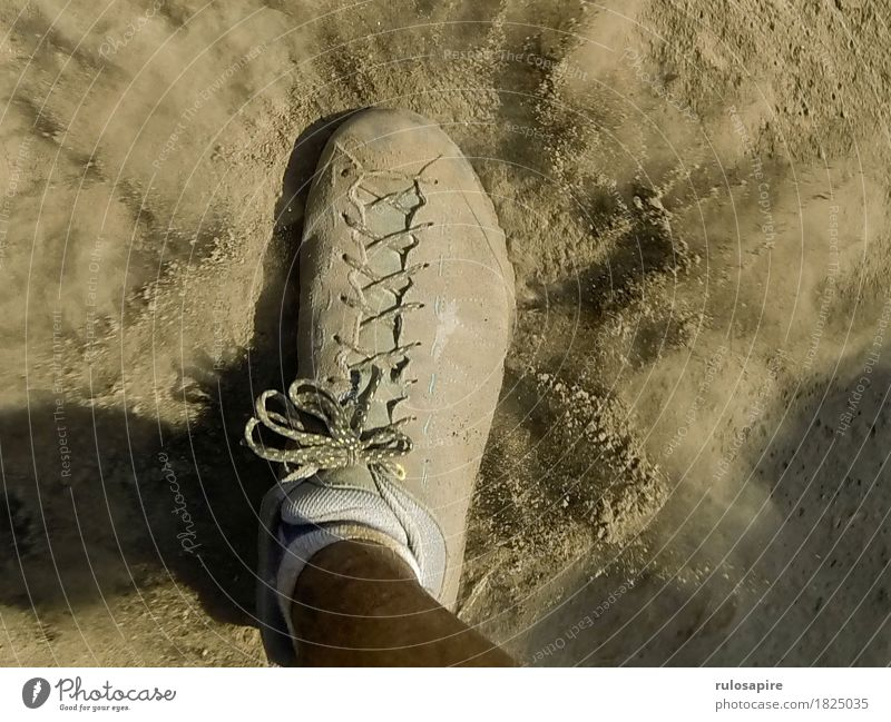 Dust Explosion 2 Feet Going Footwear Dusty Cloud of dust Lanes & trails Gray Beige Shoelace Stride Hiking Footstep Occur whirl up Colour photo Subdued colour