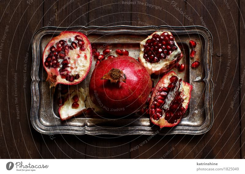 Open fresh ripe pomegranates Red Wood Brown Metal Fruit Nutrition Fresh Delicious Exotic Slice Vegetarian diet Diet Juicy Tasty Tray