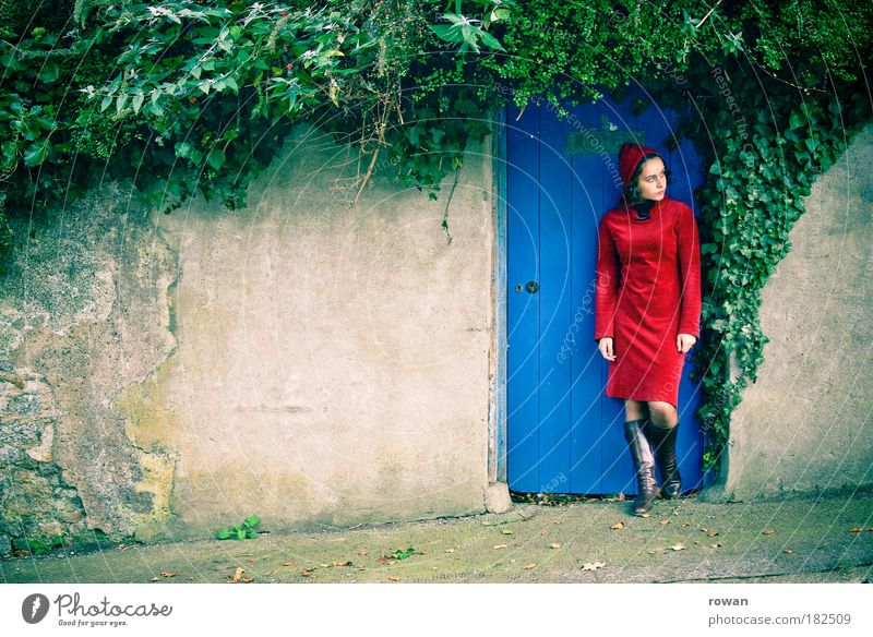 Woman Human being Youth (Young adults) Blue Red Dark Feminine Dream Sadness Wall (barrier) Wait Adults Door Esthetic Stand