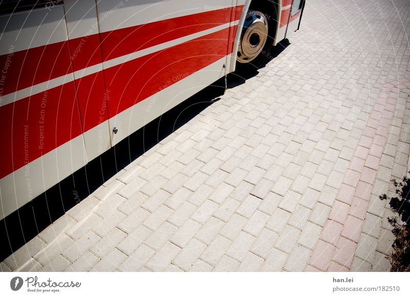 Red Street Road traffic Ground Stripe Bus Cobblestones Tire Vehicle Light Passenger traffic Means of transport Public transit Bus travel