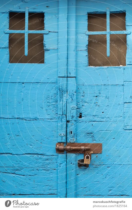 Blue door Village Old town Door Beautiful Vintage Lock Doorframe Croatia Mediterranean sea Dry Wood Wooden door Crack & Rip & Tear Colour Flake off Keyhole