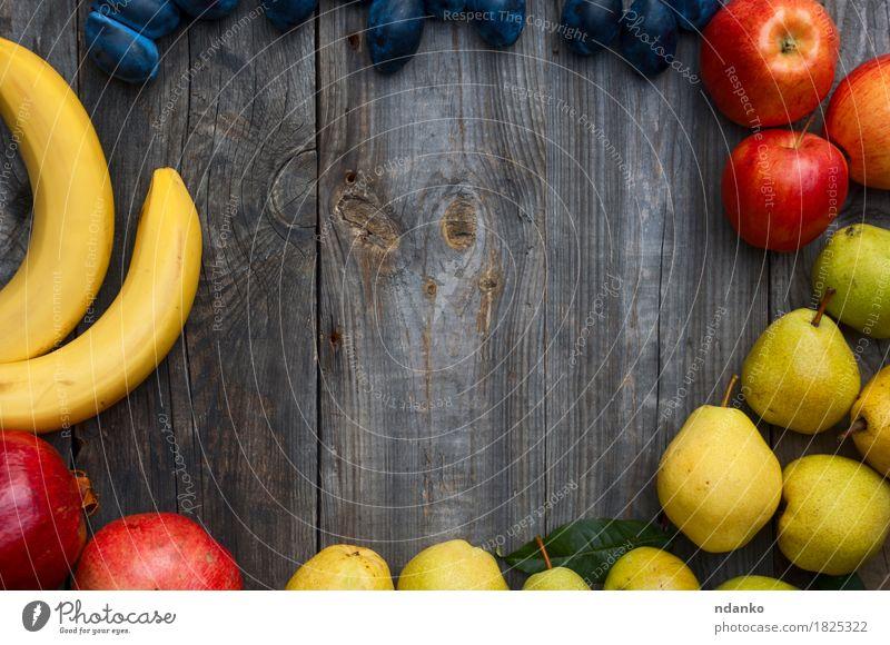 banana, apple, pear, plum and pomegranate Autumn Food Gray Fruit Fresh Vantage point Apple Top Vegetarian diet Horizontal Juicy Raw Banana Pear Plum Product
