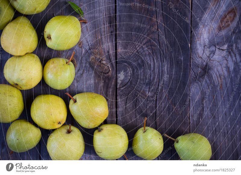 Small yellow ripe pears on a wooden gray surface Old Summer Green Tree Yellow Natural Wood Gray Fruit Fresh Table Delicious Seasons Vegetarian diet Diet
