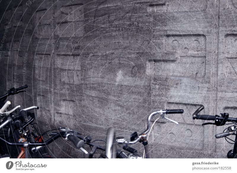 the negative Design Art Wall (barrier) Wall (building) Facade Stone Concrete Emotions Moody Authentic Uniqueness Bicycle Vandalism Structures and shapes