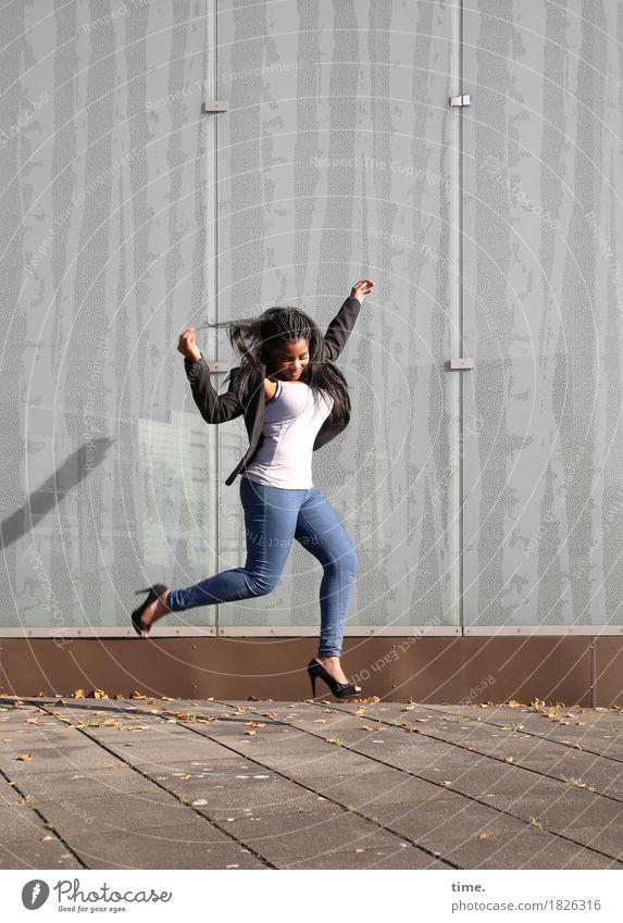 . Feminine Woman Adults 1 Human being Actor Dancer Summer Beautiful weather Wall (barrier) Wall (building) Lanes & trails Sidewalk T-shirt Jeans Jacket