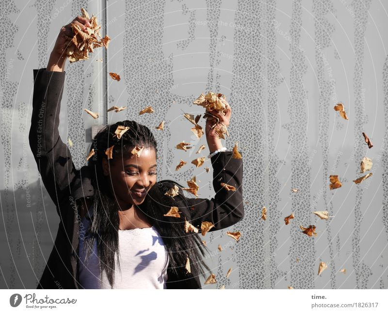 . Feminine 1 Human being Autumn Beautiful weather Leaf Wall (barrier) Wall (building) T-shirt Jacket Black-haired Long-haired Dreadlocks Observe To hold on