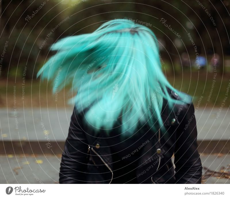 centrifugal force Exotic Joy Beautiful Young woman Youth (Young adults) Hair and hairstyles 18 - 30 years Adults Park Leather jacket Long-haired Esthetic