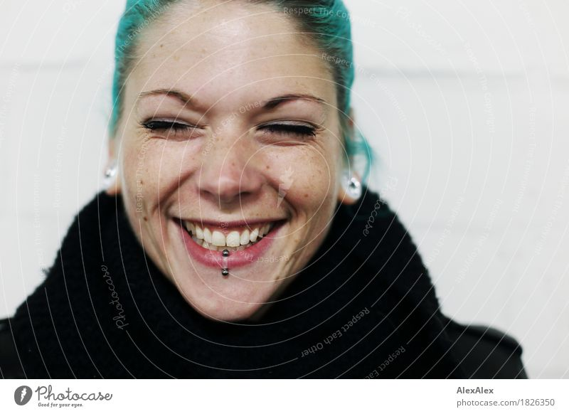 Portrait of a laughing young woman with turquoise hair Lifestyle Joy already Young woman Youth (Young adults) Face 18 - 30 years Adults peel Piercing Earring