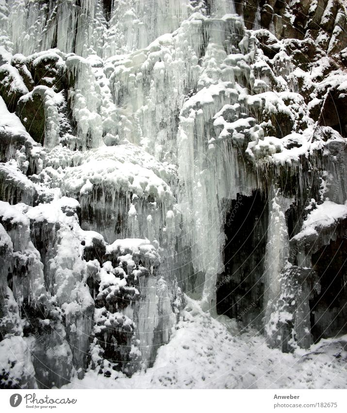 Icefall with snow and icicles Black & white photo Subdued colour Exterior shot Detail Deserted Evening Light Shadow Contrast Silhouette Environment Nature