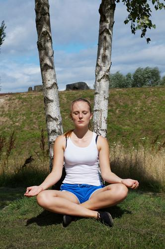 young woman meditating Lifestyle Athletic Fitness Wellness Harmonious Well-being Relaxation Meditation Leisure and hobbies Summer Sports Sports Training Yoga