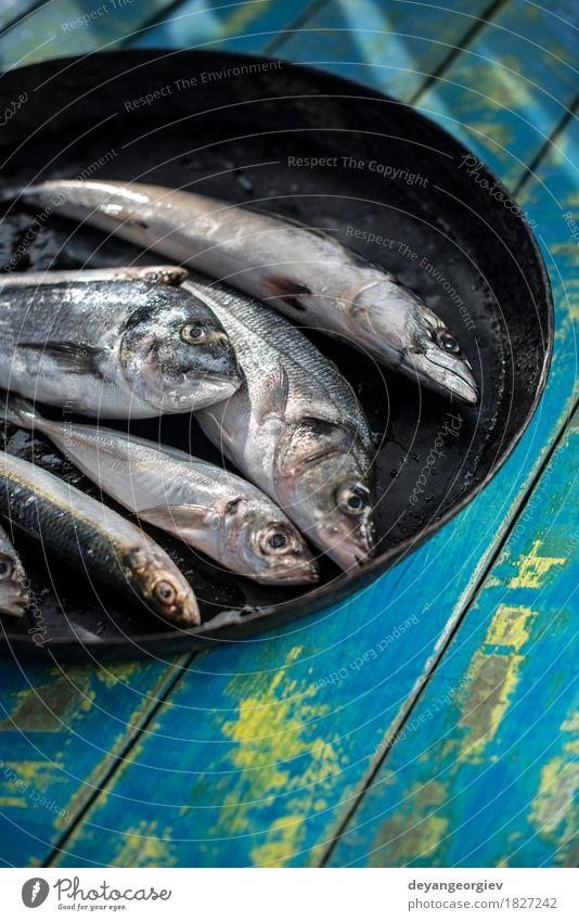 Raw fish. Sea bream, sea bass, mackerel and sardines Seafood Lunch Pan Fresh Blue Black see bass Lemon cooking background healthy Frying Fat Mackerel head