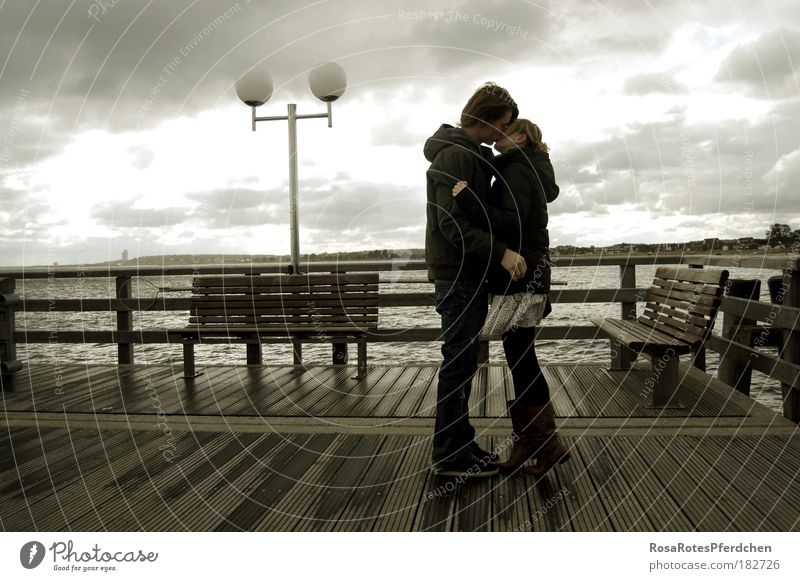 A kiss in wind and weather Kissing Couple Dark Clouds Sky Weather Lamp Ocean Bridge Love Youth (Young adults) Romance Exterior shot Lovers Relationship Trust