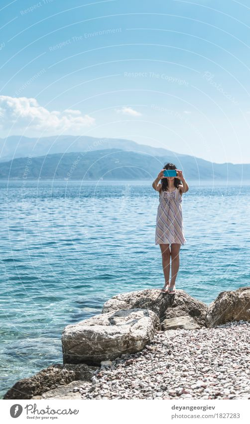 Woman taking pictures with smartphone Woman Vacation & Travel Summer Beautiful Ocean Joy Girl Beach Adults Lifestyle Happy Tourism Technology Smiling Photography Illustration