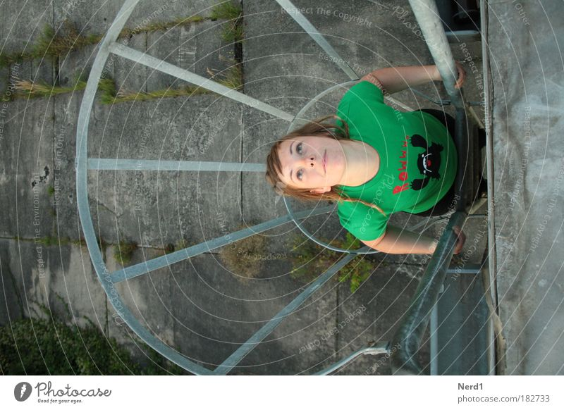 captive Green Woman T-shirt Hair and hairstyles Above Bird's-eye view Looking To hold on Young woman 18 - 30 years Face of a woman Upper body Upward Fire ladder