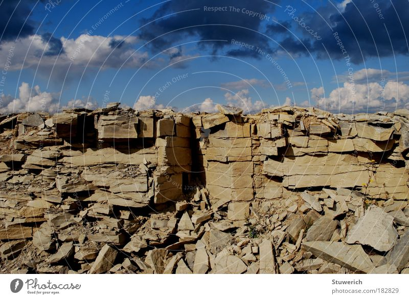 Stones and clouds in the sky Colour photo Exterior shot Structures and shapes Day Shadow Sunlight Wide angle Forward Landscape Earth Air Sky Clouds Autumn