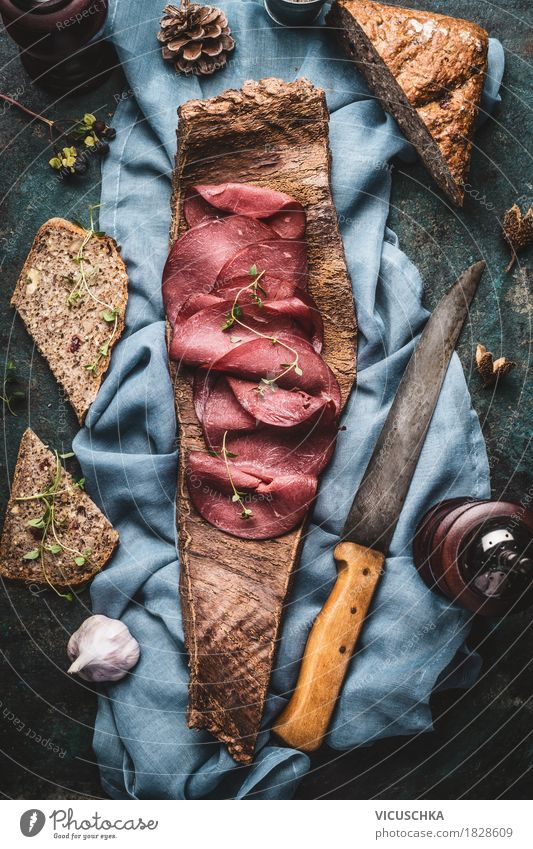 Venison ham with nut bread served on tree bark Food Meat Sausage Bread Nutrition Lunch Dinner Organic produce Knives Style Design Healthy Eating