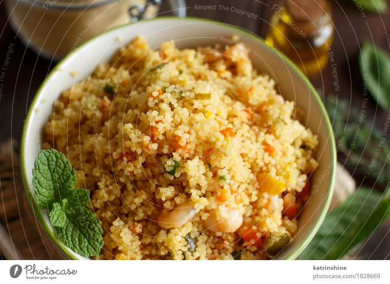 Couscous with shrimps and vegetables in a bowl Seafood Vegetable Herbs and spices Cooking oil Lunch Dinner Bowl Brown Yellow Tradition Africa african Algerian