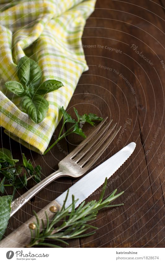 Vintage fork and knife on a colorful napkin Old Green Dark Yellow Brown Bright Arrangement Retro Table Places Herbs and spices Dinner Shabby Tablecloth Cutlery