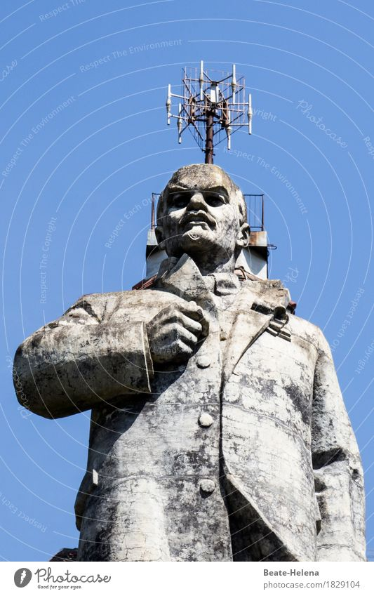 Anticapitalism crowned Lenin Tourist Attraction Landmark Sign Observe Wait Exceptional Threat Famousness Dirty Gigantic Rebellious Blue Gray Emotions Moody