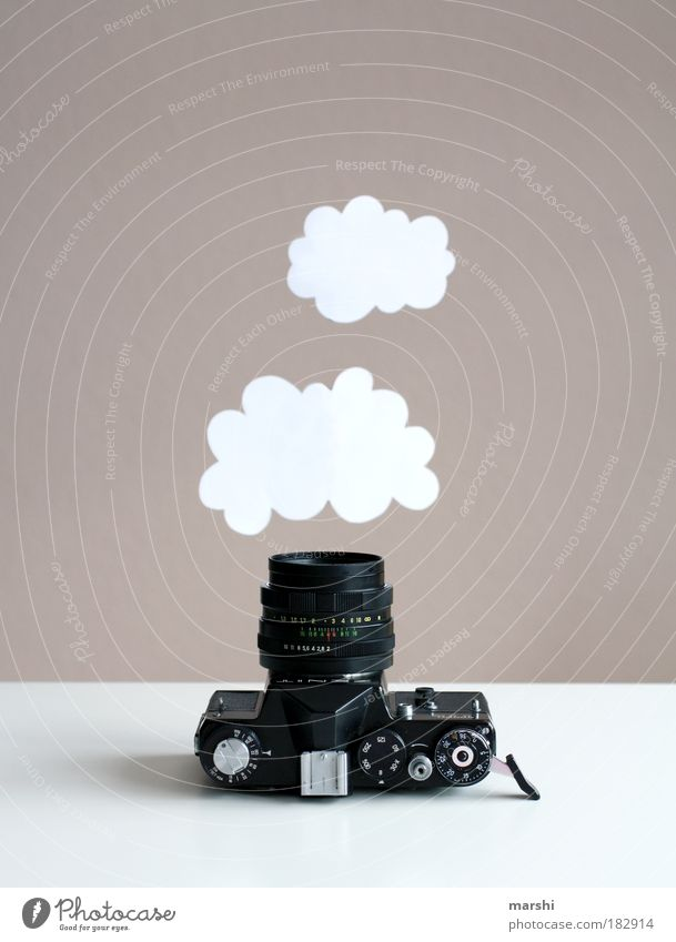 Capturing dream clouds Colour photo Interior shot Style Leisure and hobbies Clouds Hang Old White Camera Photography Take a photo Photographer Analog Capture