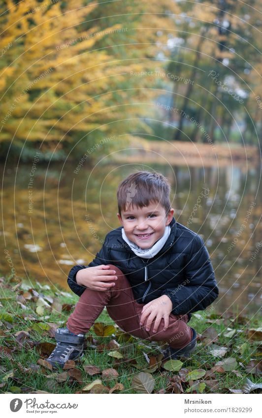 At the lake Joy Human being Toddler Boy (child) Family & Relations Infancy 1 3 - 8 years Child Crouch Smiling Laughter Looking Autumn Autumnal Leaf Lakeside