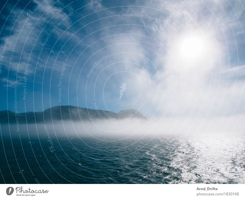 Sky Vacation & Travel Blue Water Sun Ocean Landscape Clouds Far-off places Mountain Environment Coast Freedom Weather Fog Air