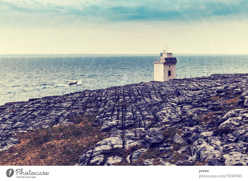 small light Water Sky Rock Waves Coast Ocean Island Ireland Lighthouse Building Fishing boat Driving Small Blue Brown Gray White Bizarre Horizon Colour photo