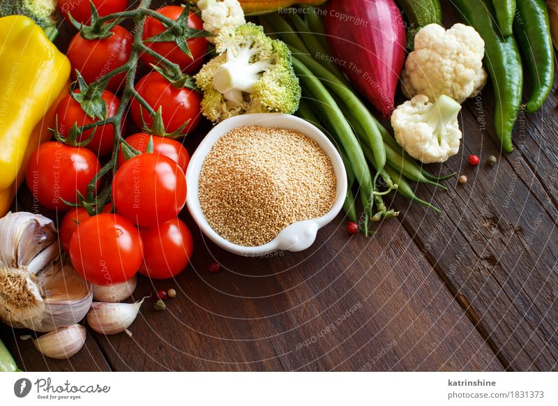 Raw Amaranth Grain in a bowl and vegetables Green Red Yellow Natural Fresh Herbs and spices Vegetable Bowl Meal Vegetarian diet Diet Tomato Dried Ingredients
