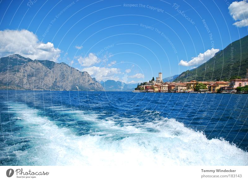 Nature Water Vacation & Travel Summer Clouds Far-off places Mountain Lake Waves Tourism Alps Beautiful weather Italy Lakeside Castle Navigation